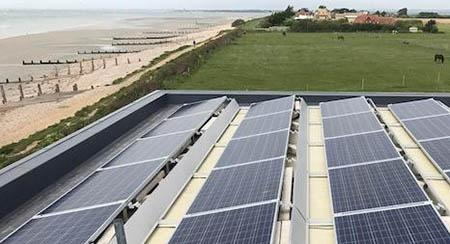 solar panels on flat roof in countryside