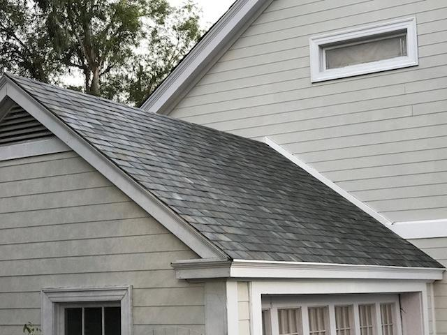 Tesla Solar Roof tiles on a detached house